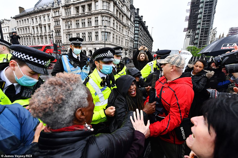 Photos showed police attempting to contain a large group of covid sceptics in Parliament Square, as some protestor offered 'free hugs' to others without masks
