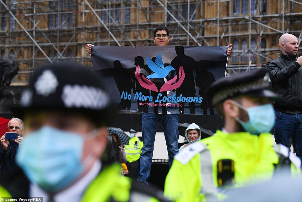 The protest comes as Boris Johnson today poured cold water on the prospect of easing the remaining coronavirus rules early as he refused to rule out future lockdowns and warned the nation should brace for a 'rough winter'