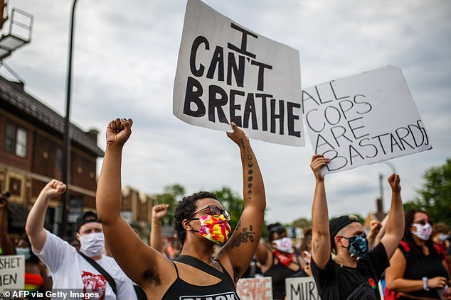 Black Lives Matter protesters are seen in Minneapolis, 20 miles from Lakeview, on May 26, 2020 - the day after George Floyd was killed