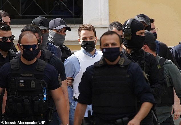 Babis Anagnostopoulos pictured arriving at court today where he is expected to recount a confession he gave to police last week that he smothered wife Caroline Crouch to death