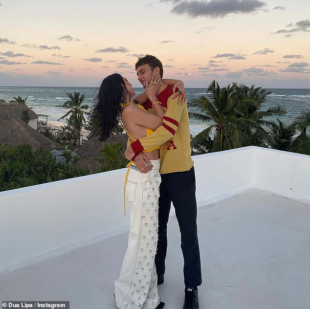 Sweet:The singer, 25, shared a series of loved-up throwback snaps of herself and her model beau, as she declared: 'You make my world so much better!'