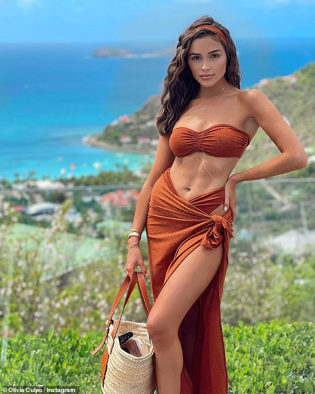 She looks good in anything! The siren also modeled this rust colored bikini with a skirt