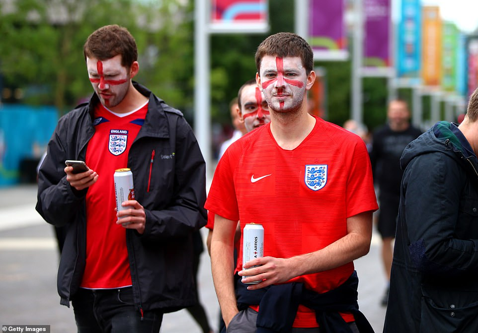 Three Lions fans with England flag face paint and cans of Stella Artois were earlier pictured strolling along Wembley Walk ahead of the game