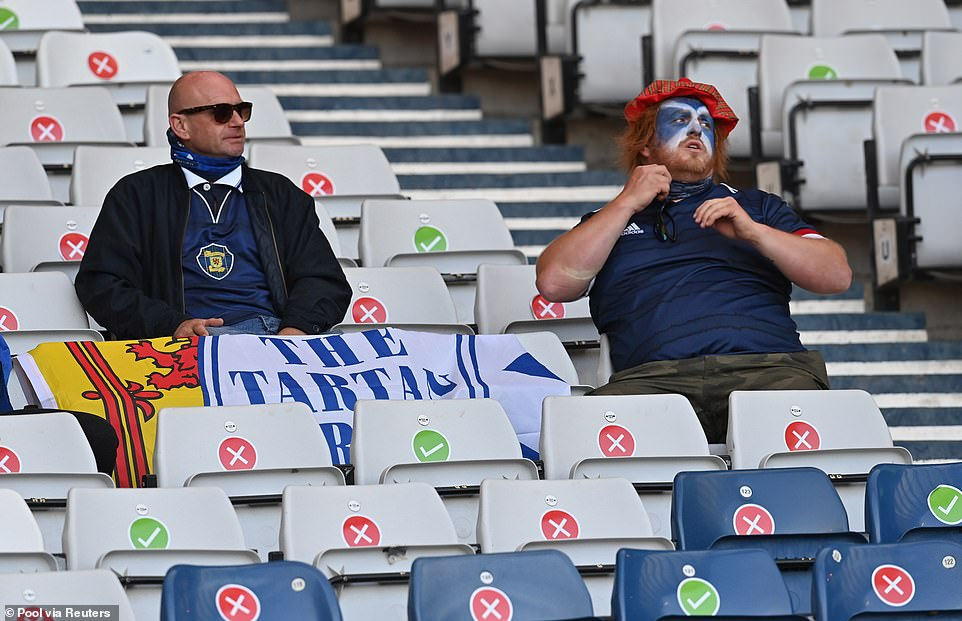 One fan was seen with Scotland flag face paint, while another had a flag for the Tartan Army at Hampden Park tonight