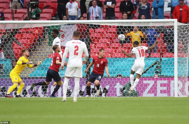 Sterling keeps his eye on the ball as he simply nods the ball into the back of the Czech Republic net in the 12th minute