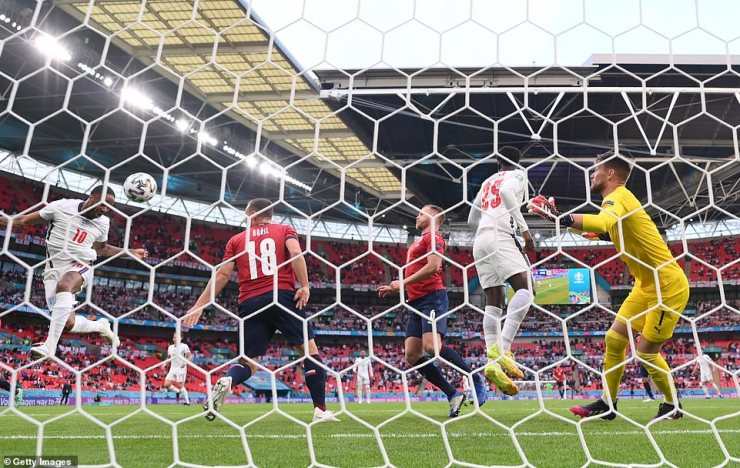 The Czech Republic defenders can only stand and stare as Sterling heads in the opener in England's final group game