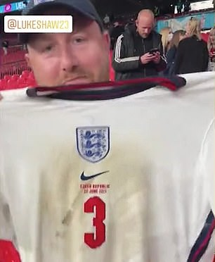 The fan posed with the shirt on Instagram, saying it was 'f****** soaking!'