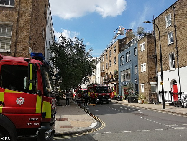 Firefighters descended on the blaze that raged on Wednesday afternoon (pictured)