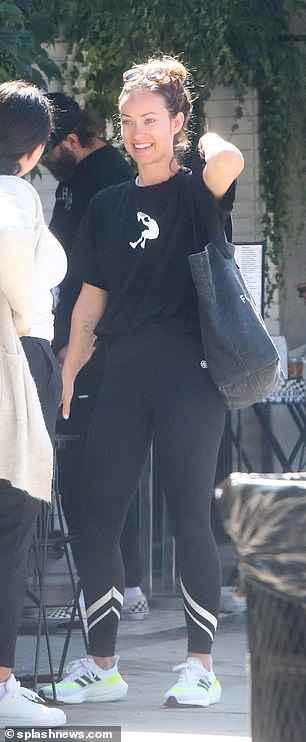 Casual: She tied up her light brown hair into a messy bun and positioned a pair of sunglasses on top of her head