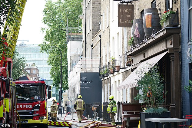 Several firefighters were also seen outside the pub with hoses while working at the building