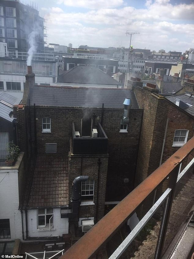 Pictures taken by an eyewitness show white smoke coming out of the chimney and a door
