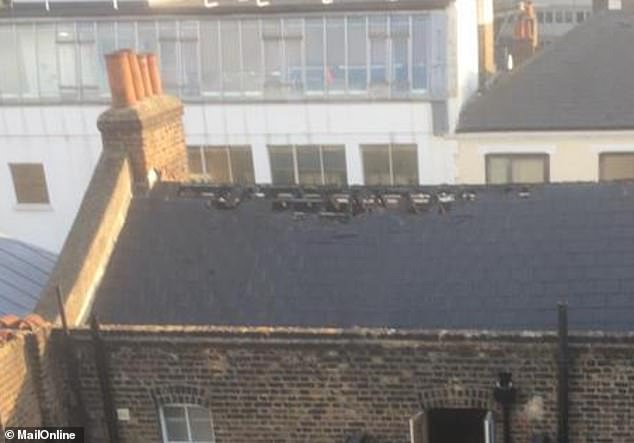 While trying to stop the flames, firefighters ripped off dozens of roof tiles to let the smoke out, according to an eyewitness