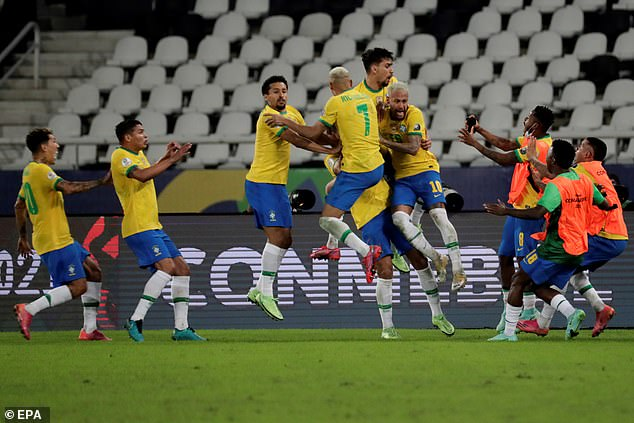 Brazil's players mob Casemiro as they celebrate a thrilling comeback victory