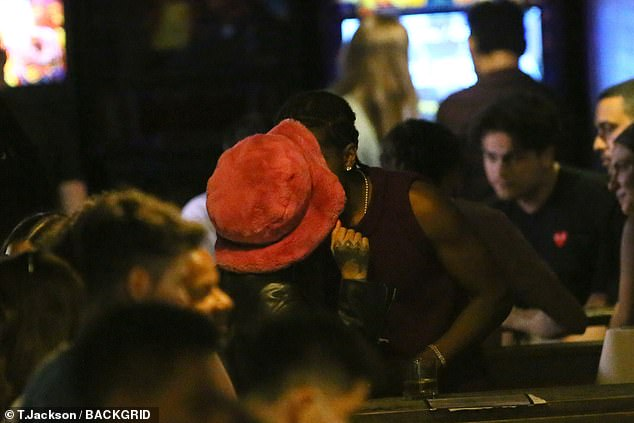 Living life in the city: Rihanna and A$AP shared a passionate kiss by the bar as they enjoyed their night out in New York