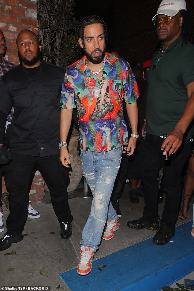 Quirky: French Montana wore a colourful shirt with a graphic print on the front with jeans