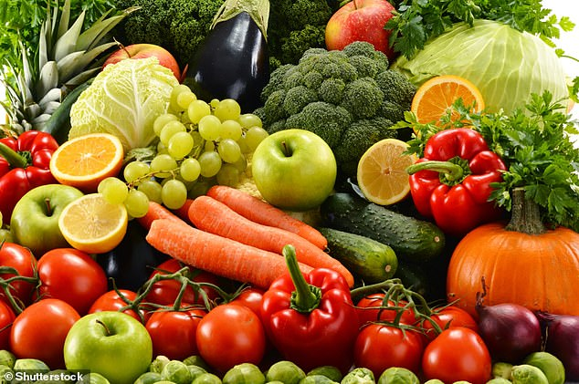 The NHS says we should be eating at least five portions of fruit and veg per day, if one portionweighs 80 grams (stock image)