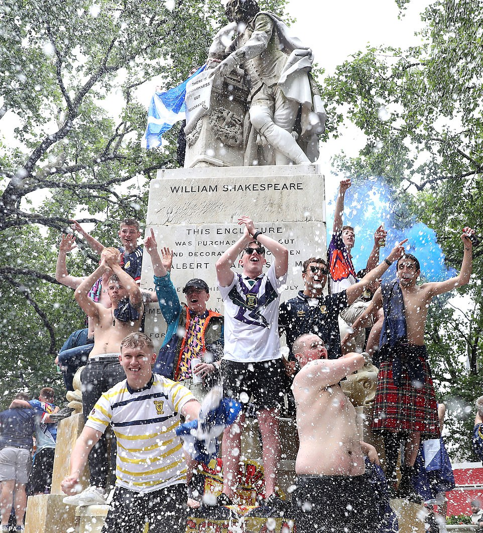 Fans seized the opportunity to jump into the fountain in Leicester Square and take off their shirts as they sprayed water over each other. Footage from after the game showed members of the Tartan Army chanting at the statue: 'You're just a s**** Rabbie Burns', in reference to the Scottish poet Robert Burns