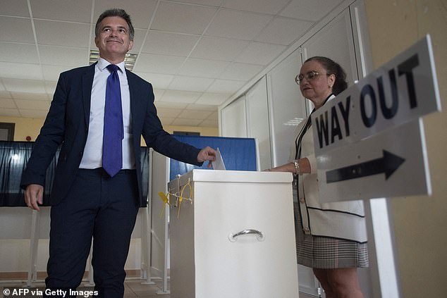 Leader of the Opposition of Gibraltar and leader of the Gibraltar Social Democrats Keith Azopardi casts his ballot