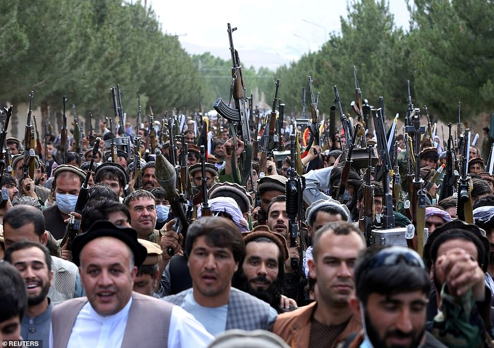 Hundreds of militiamen shout 'death to the Taliban' as they join government forces in Kabul ahead of what is expected to be a major jihadist assault