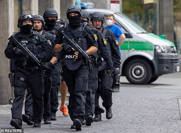 Armed police walk in the German city ofWurzburg on Friday during a 'major operation' in whicha 24-year-old Somali man was arrested after reports of multiple stabbings