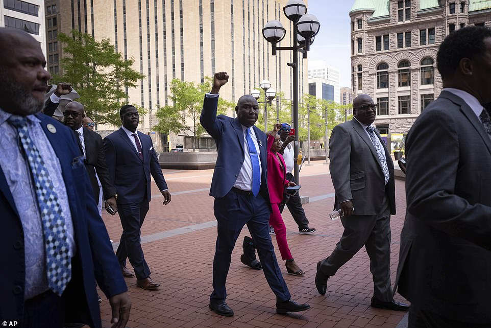 Attorney Ben Crump is pictured walking into the Hennepin County Government Center before the sentencing began