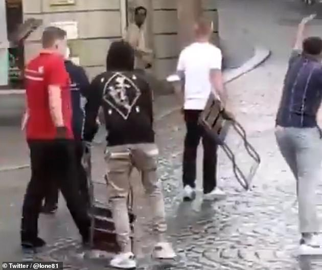 Videos posted on social media showed a young man seemingly holding a knife being warded off by other men holding chairs until police arrived