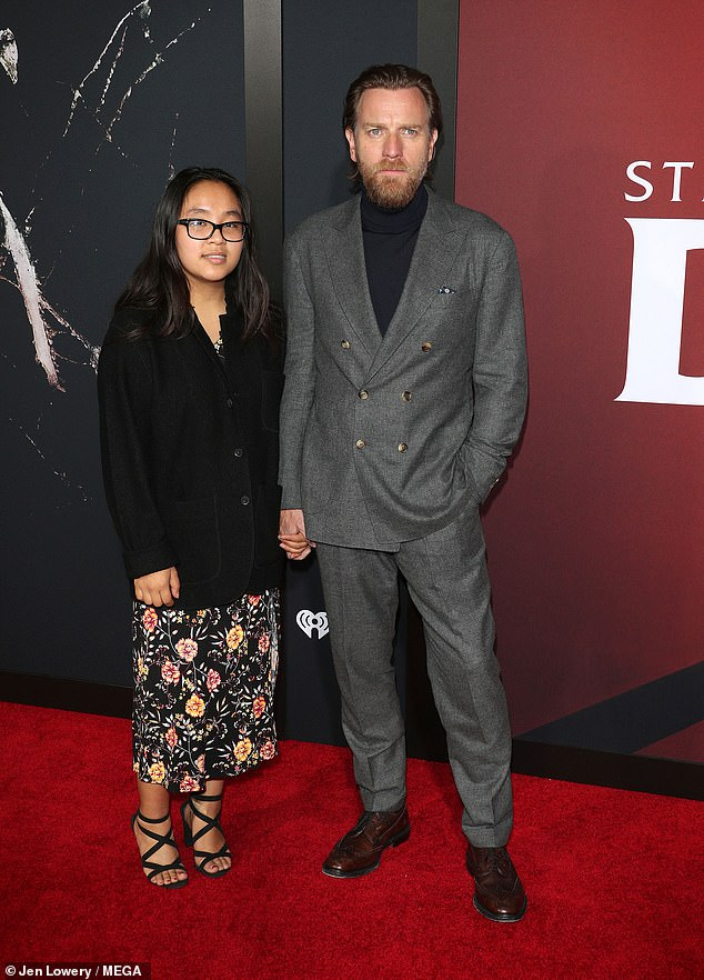 Fatherhood: This isn't the first time Ewan has surprised fans with secret baby news, previously revealing in 2011 that he adopted a girl (pictured with his daughter Jamyan in 2019)
