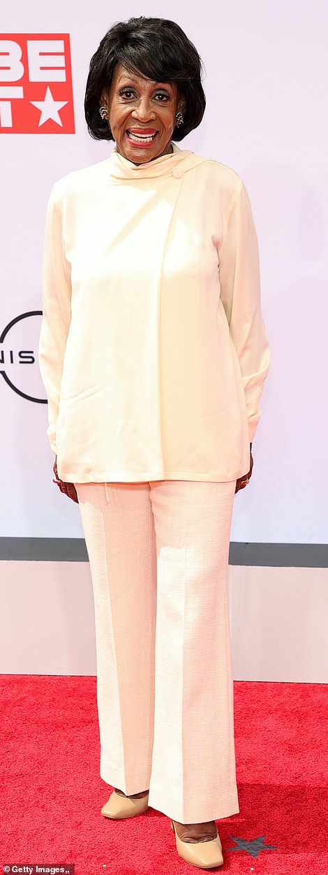 Strike a pose! Congresswoman Maxine Waters kept it simple and chic with her cream ensemble