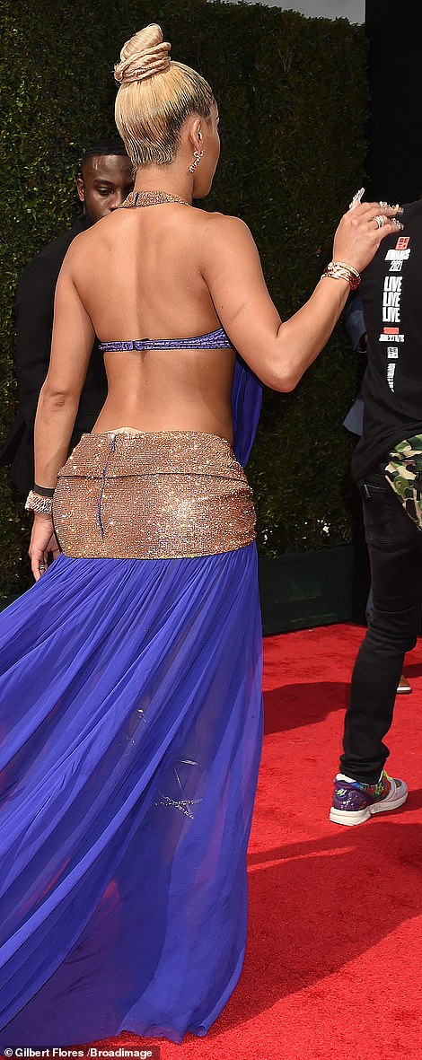 Back view: Saweetie accessorized her red carpet attire with Bulgari jewelry