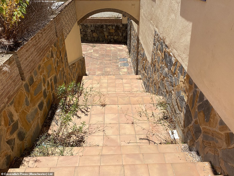 The once immaculate exterior corridors with their pristine plants are now infested with overgrown or dead shrubs