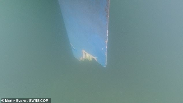 Later in the clip, the camera plunges into the water to reveal the damaged rudder, the end of which has been shredded