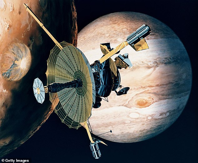 NASA's Galileo probe is depicted here in this artist's impression passing over one of Jupiter's moons