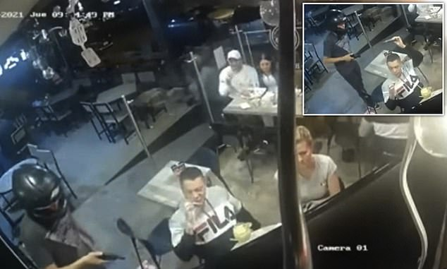 A man has gained the respect of social media users after footage of him calmly continuing to eat chicken wings during an armed robbery went viral