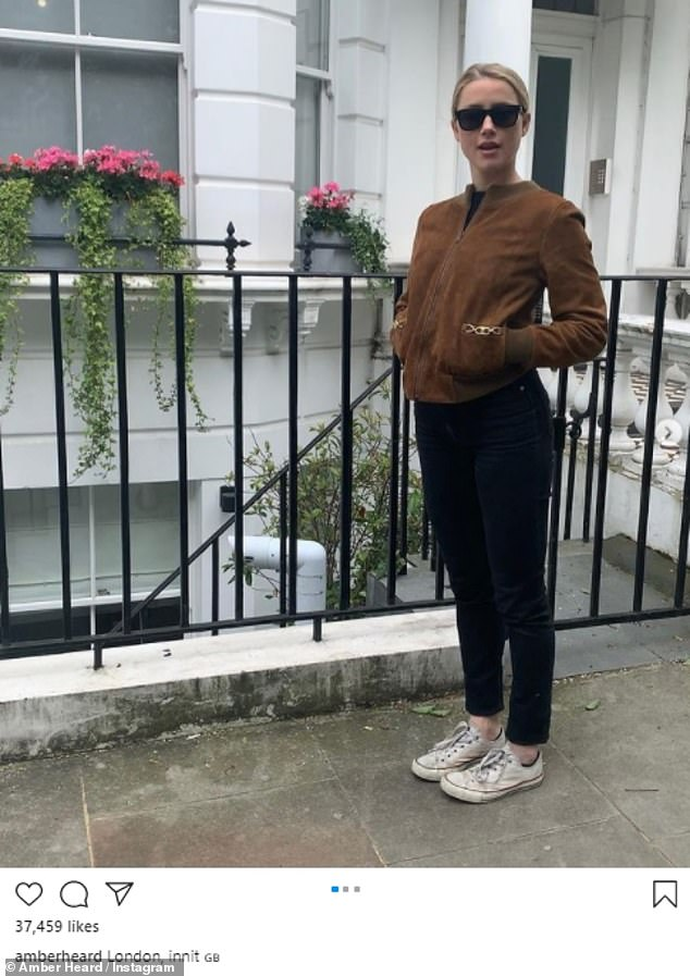 Across the Pond: Amber shared candid snaps of herself on a London street on Instagram on Monday - after it was announced the highly anticipated Aquaman sequel would be filming in the UK