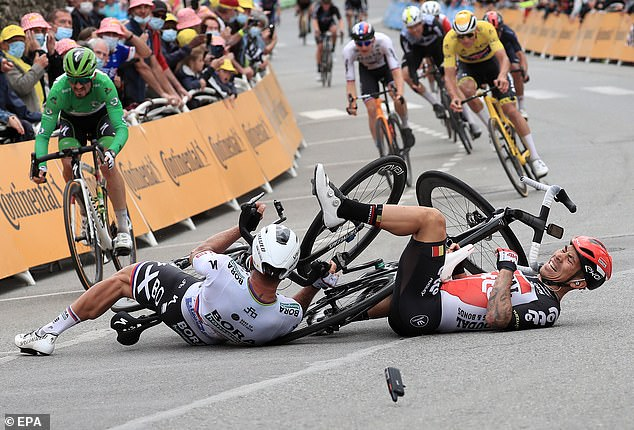 Caleb Ewan (right) also suffered a crash after his front wheel slid from under him, taking down Peter Sagan with him