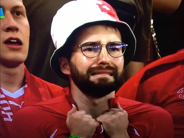 A Swiss fan encapsulated the agony and ecstasy of football last night as he was seen on the verge of tears as time ran out against France. Two minutes before his team levelled in the 91st minute, he wasseen wracked with despair as Swiss hopes ebbed away
