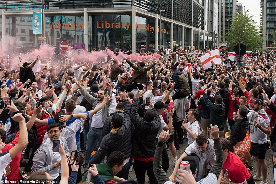 England football fans celebrate outside Wembley Stadium ahead of the match against Germany