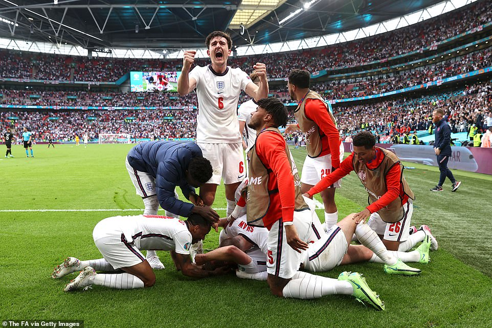 Prince George watched as England crushed Germany 2-0 at his first international football match - as an estimated 25 million fans tuned in to watch the Three Lions storm to a glorious victory (the team, celebrating) on the pitch
