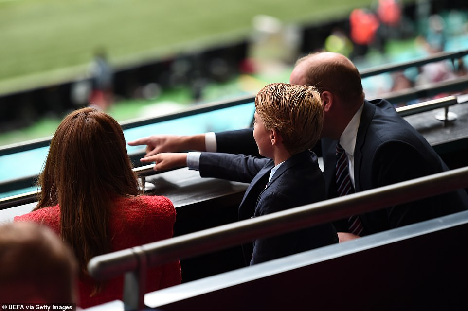 Prince William pointed out features of the pitch to his son, as the pair watched the game in identical suits and ties