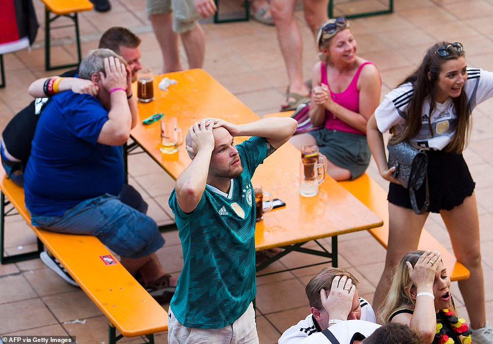 German fans held their heads in their hands and drowned their sorrows in beer as they watched their side lose tonight
