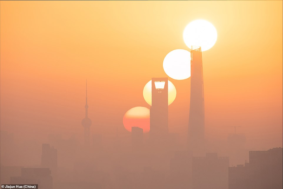 Shanghai is one of China's most developed cities and in this image you can see the sun rising over a haze-filled skyline, in a picture named Sunrise of the Magic City by Jiajun Hau
