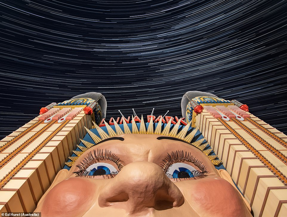 This huge face found at the entrance of Luna Park, a long-shut theme park on Sydney's harbourside is seen here with star trails in the background in an image by Ed Hurst