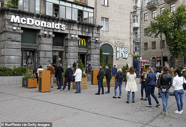 People are stand queue to McDonald's in central Kyiv - a branch reputedly the third busiest in the world