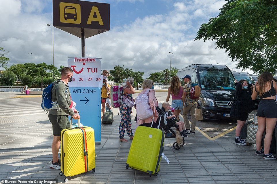 Some Brits have thought the extra expense was worth it, as they were pictured smiling as they arrived at airports in Mallorca and Ibiza on Wednesday. Pictured: British tourists outside Ibiza airport on Wednesday