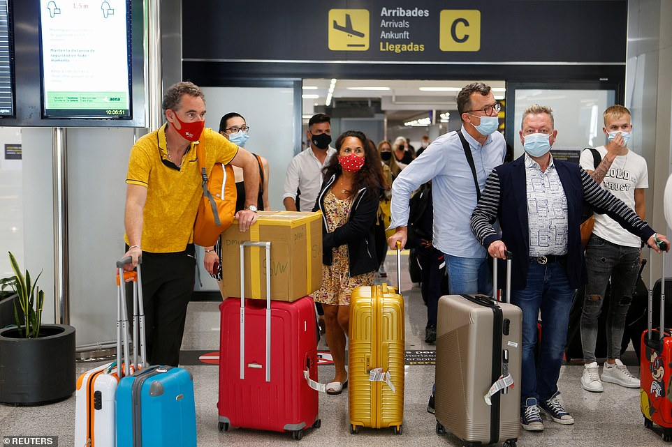 They are among thousands of Britons who now do not have to quarantine for 10 days when arriving back in the UK. Pictured: British tourists arrive in Mallorca on Wednesday
