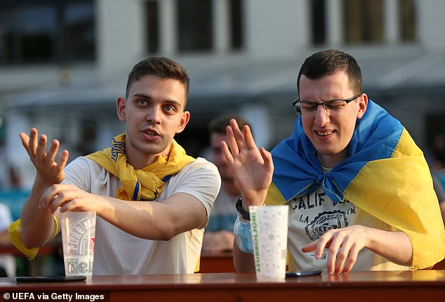 Fans from the big drinking country watch the Ukraine vs Austria match on June 21, 2021
