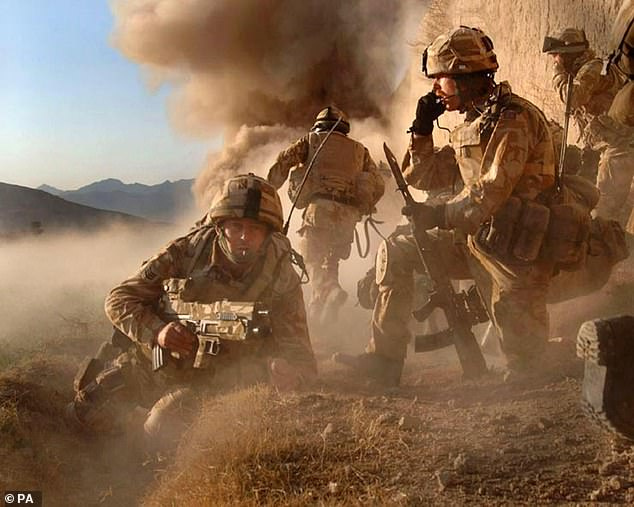 The last British troops in Afghanistan are to leave 'within days' after American forces brought forward their withdrawal date to mark US Independence Day. Pictured: M Company, 42 Commando Royal Marines, during operation against Taliban forces in Barikyu, Nothern Helmand Province of Afghanistan