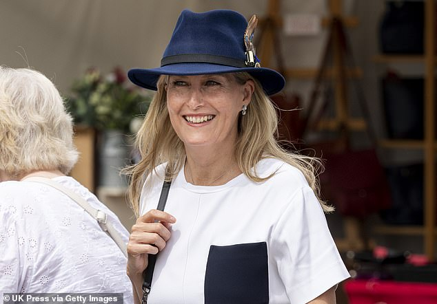Beaming! Wearing her hat and casual t-shirt, the Queen's daughter-in-law seemed to be enjoying her time at the horse show today