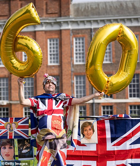 Royal fan John Loughrey poses with balloons as supporters gather to mark what would have been the 60th birthday of Princess Diana