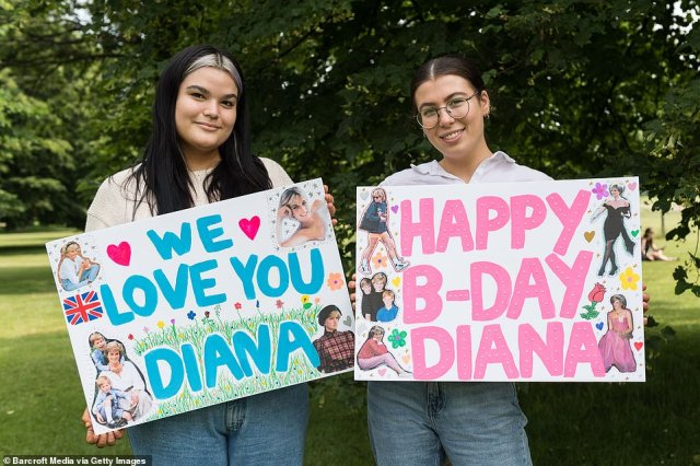 Friends hold homemade banners wishing Diana a happy birthday and declaring their love for her